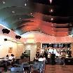 Матовый черный натяжной потолок в ресторане в виде волны
